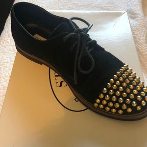 Black shoe with gold spike studs. Worn once